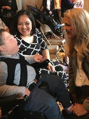 Rosalie Howes and her son, Hyrum, meet Rep. Robin Smith, R-Hixson, in the Legislative Library. They were there Wednesday, April 24, 2019, to celebrate the House's passage of a budget that would provide TennCare funding for children with severe disabilities who cannot qualify for state health insurance.