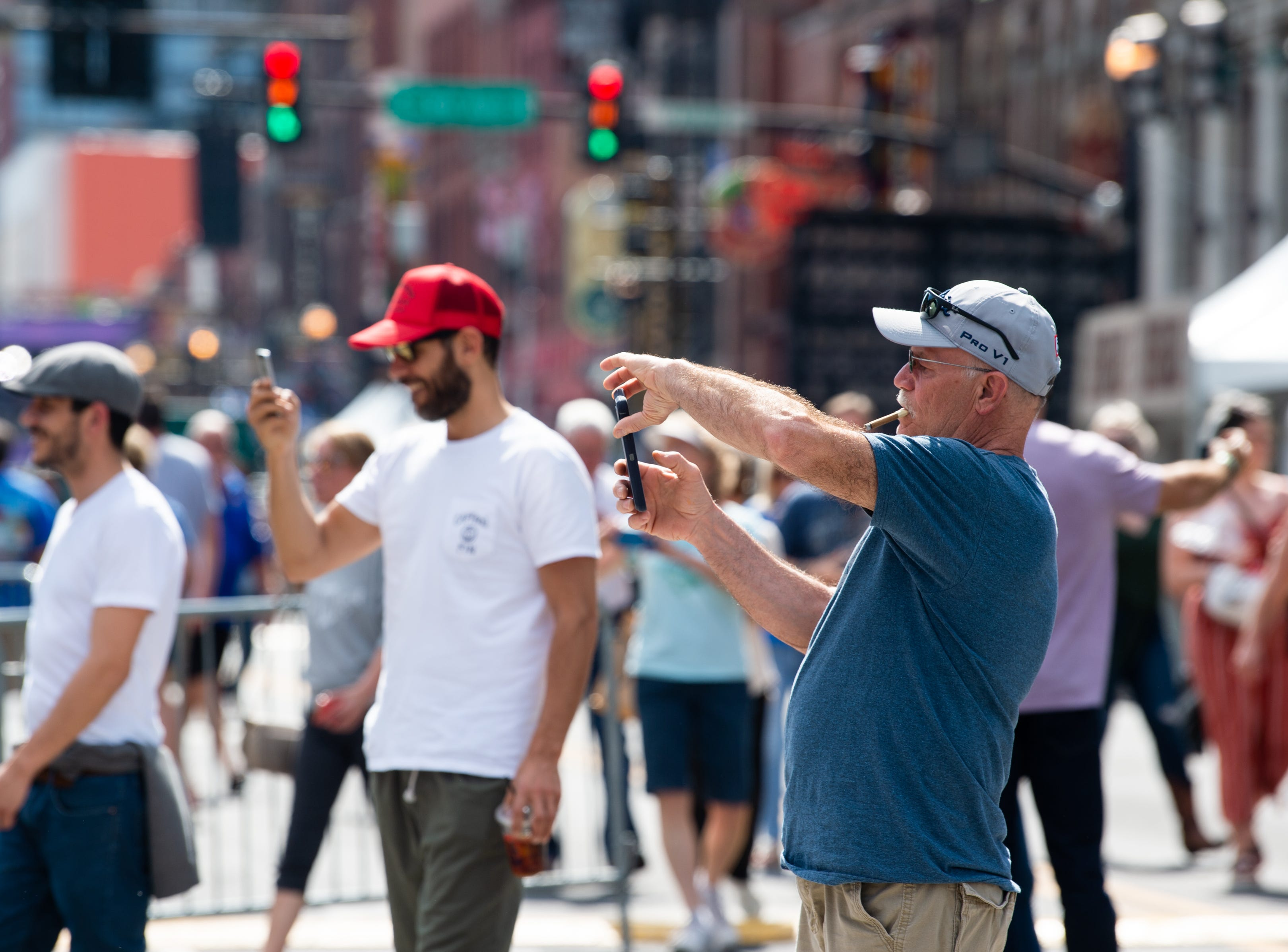 People take photos along Broadway before the NFL Draft Wednesday, April 24, 2019, in Nashville, Tenn.