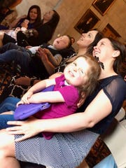 Tori Goddard and her daughter, Zoey Jones, sit next to Rosalie Howes and her son, Hyrum, in the Legislative Library on April 24, 2019.