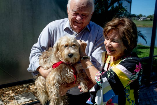 """Jim and Linda Hansen with their dog, Lizzie, at their home in Naples Lakes Country Club on Tuesday, April 23, 2019. The Hansens received Lizzie through the """"Lucky Dog"""" TV series and will appear on the show with Lizzie at 12:30 p.m. on Saturday, April 27, on CBS."""