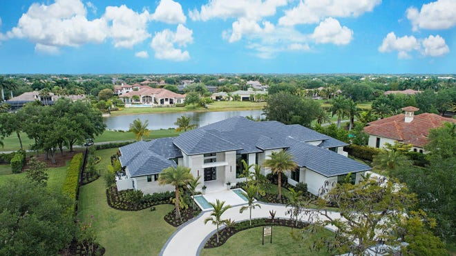 An aerial view of the Laurène estate model, one of five projects completed in five months by Diamond Custom Homes in Quail West Golf & Country Club.