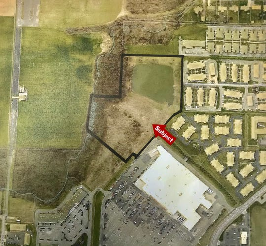 The subject area outlined in black, located between Walmart and the Newark Area Soccer Association fields, could be the home of an affordable housing complex, adjacent to an existing pond.