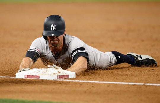 Anaheim, CA, USA; New York Yankees center fielder Brett Gardner (11) reaches third on a triple hit during the third inning against the Los Angeles Angels at Angel Stadium of Anaheim.