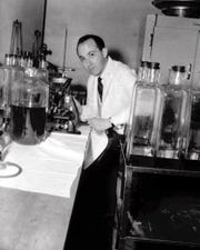 Dr. Jonas Salk is shown at work in Pittsburgh's Municipal Hospital laboratory in this April 18, 1955 file photo. Salk and his colleagues at the University of Pittsburgh developed a Polio vaccine that was approved for use in the United States in 1955.
