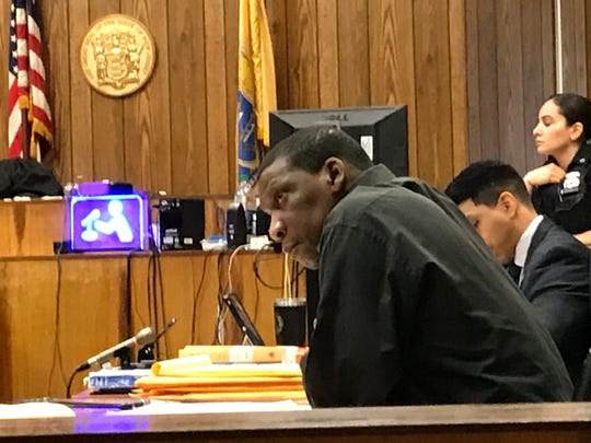 Harold Johnson, 51, listening to testimony on Wednesday, April 24, 2019, the first day of his murder trial.