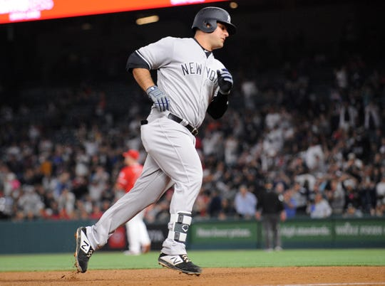 New York Yankees first baseman Mike Ford (36) rounds the bases after hitting a two run home run against the Los Angeles Angels during the fifth inning at Angel Stadium of Anaheim on Tuesday, April 23, 2019.