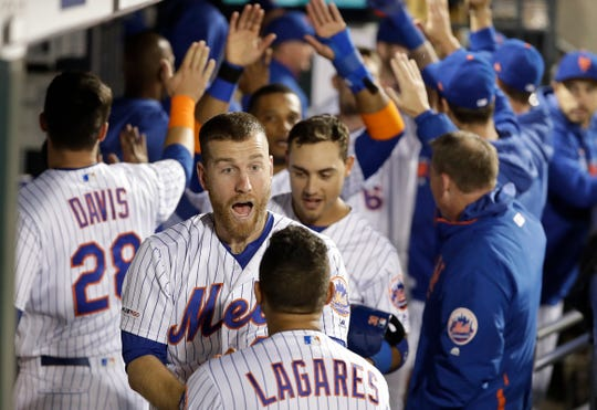 New York Mets' Todd Frazier, center, celebrates with teammates after hitting a grand slam home run during the fifth inning of a baseball game against the Philadelphia Phillies Tuesday, April 23, 2019, in New York. (AP Photo/Frank Franklin II)