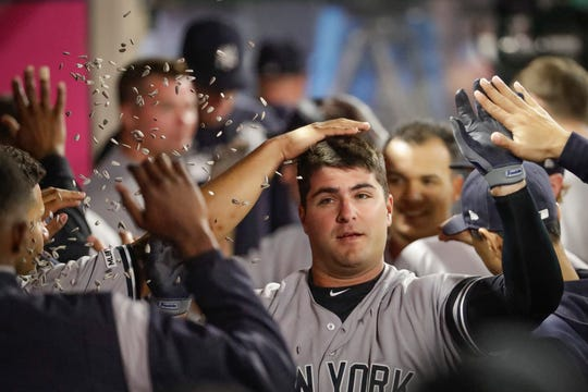 New York Yankees' Mike Ford celebrates in the dugout after scoring after his two-run home run against the Los Angeles Angels during the fifth inning of a baseball game in Anaheim, Calif., Tuesday, April 23, 2019. (AP Photo/Chris Carlson)