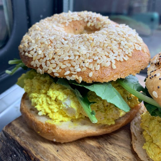 The gluten-free bagel at Planted Eats is covered in crunchy sesame seeds.