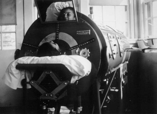 FILE PHOTO -- BERGEN PINES ...   A Polio victim in an iron lung at Bergen Pines (no year)