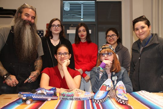The masterminds behind the Vans Custom Culture Contest. From top left, DHS art teacher Mr. Jesse Kriegel, DHS seniors Maddy Jackson, Guadalupe Sanchez, Andrea Casillas, and DHS teacher Lizeth Gomez. From buttom left, senior artists Sarah Ortiz and Tina Caddo.