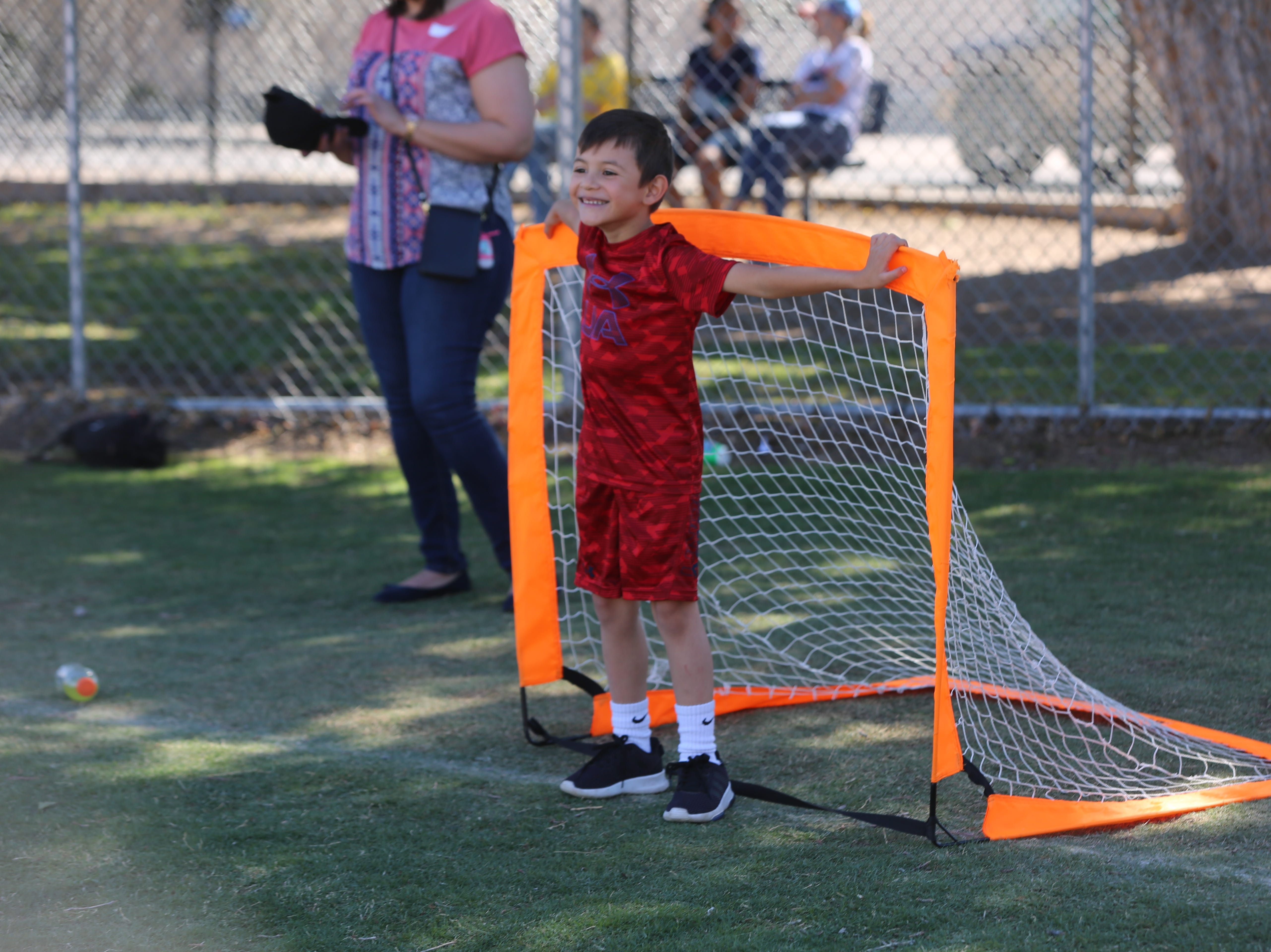 A Central Elementary School student stands in front of a soccer goalie net during a community carnival honoring the school's 70th anniversary Wednesday, April 24.