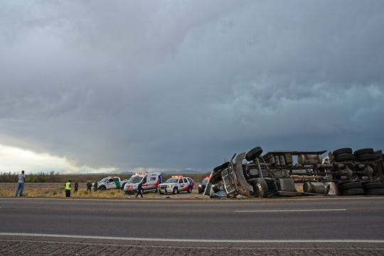 Emergency crews respond to a semi-truck crash on Interstate 10 west of Las Cruces on Tuesday, April 23, 2019.