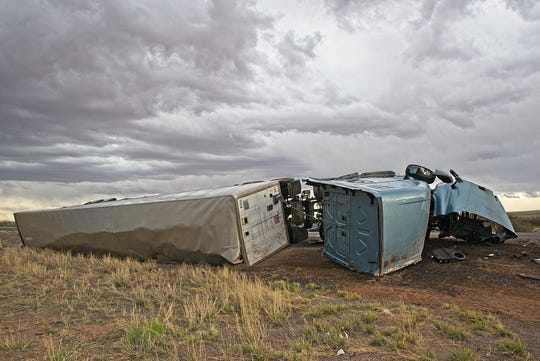A semi-truck is on its side the evening of Tuesday, April 23, 2019 after it crashed while traveling eastbound Interstate 10 west of Las Cruces.