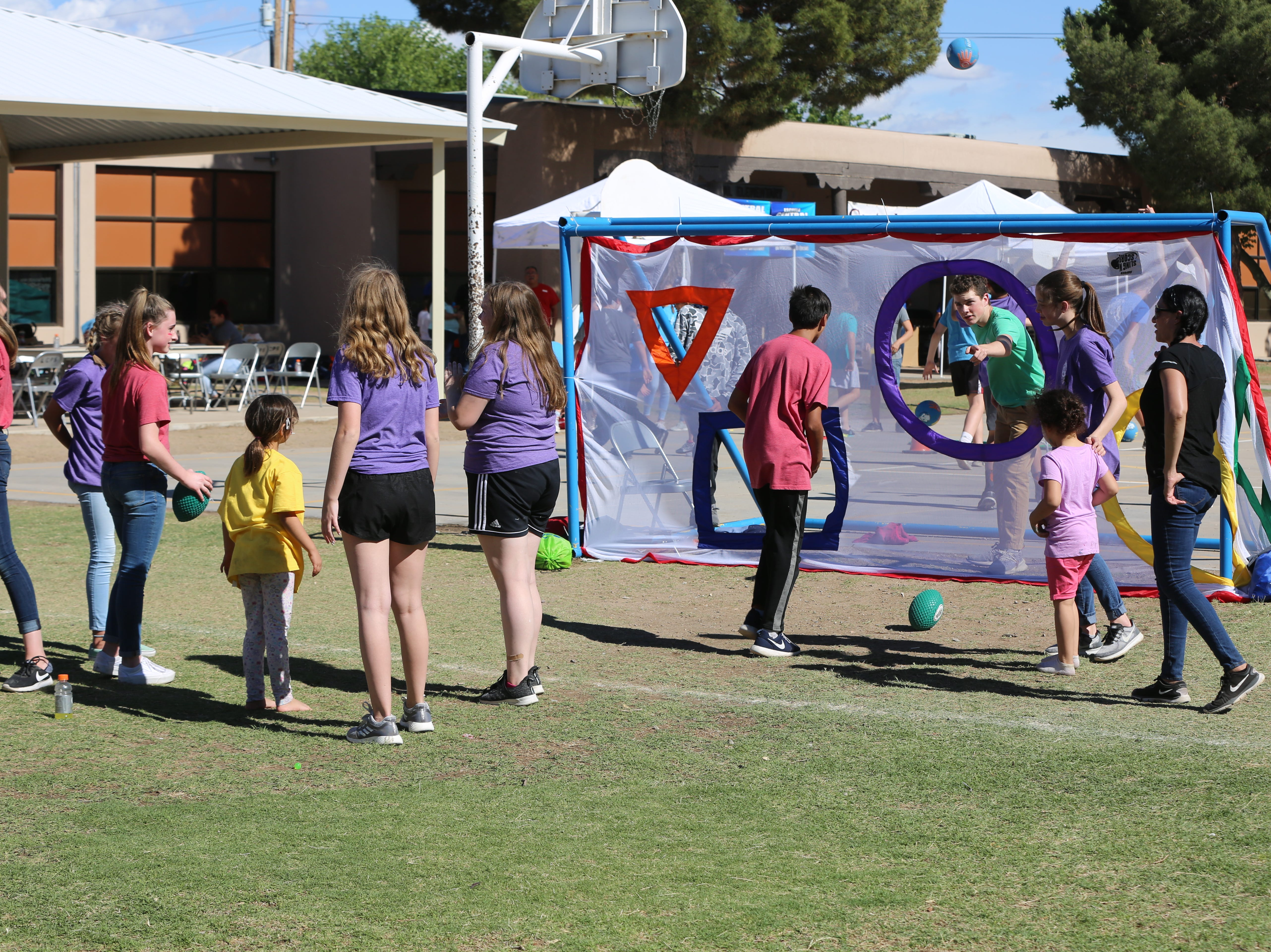 Students from Central Elementary School and Cherry Hills Middle School in Highlands Ranch, Colorado, play games during a community carnival to honor Central Elementary's 70th anniversary Wednesday, April 24.