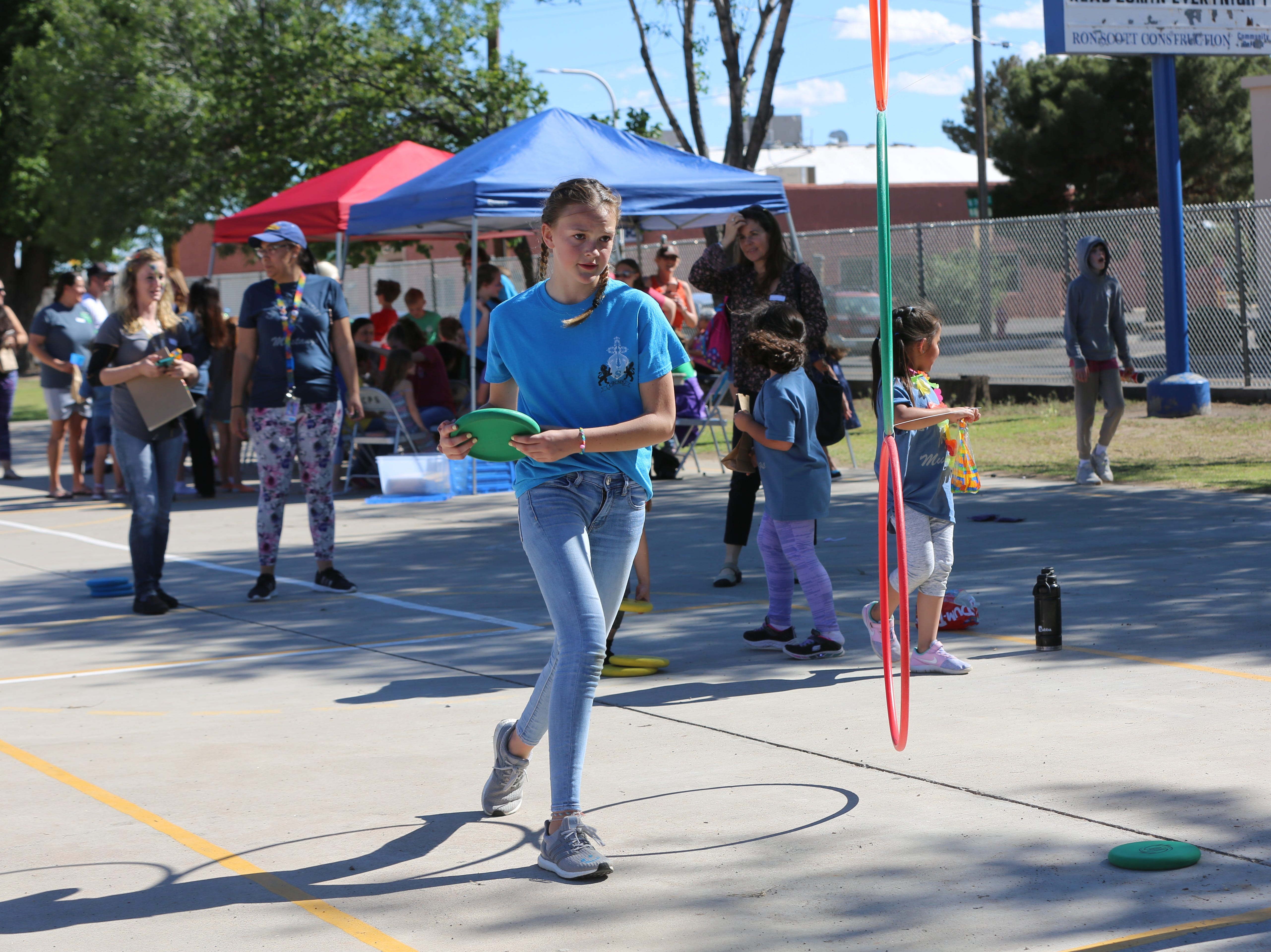 A student from Cherry Hills Middle School in Highlands Ranch, Colorado, plays a game during a community carnival to honor Central Elementary's 70th anniversary. The school in Colorado provided all the jumping balloons and games.