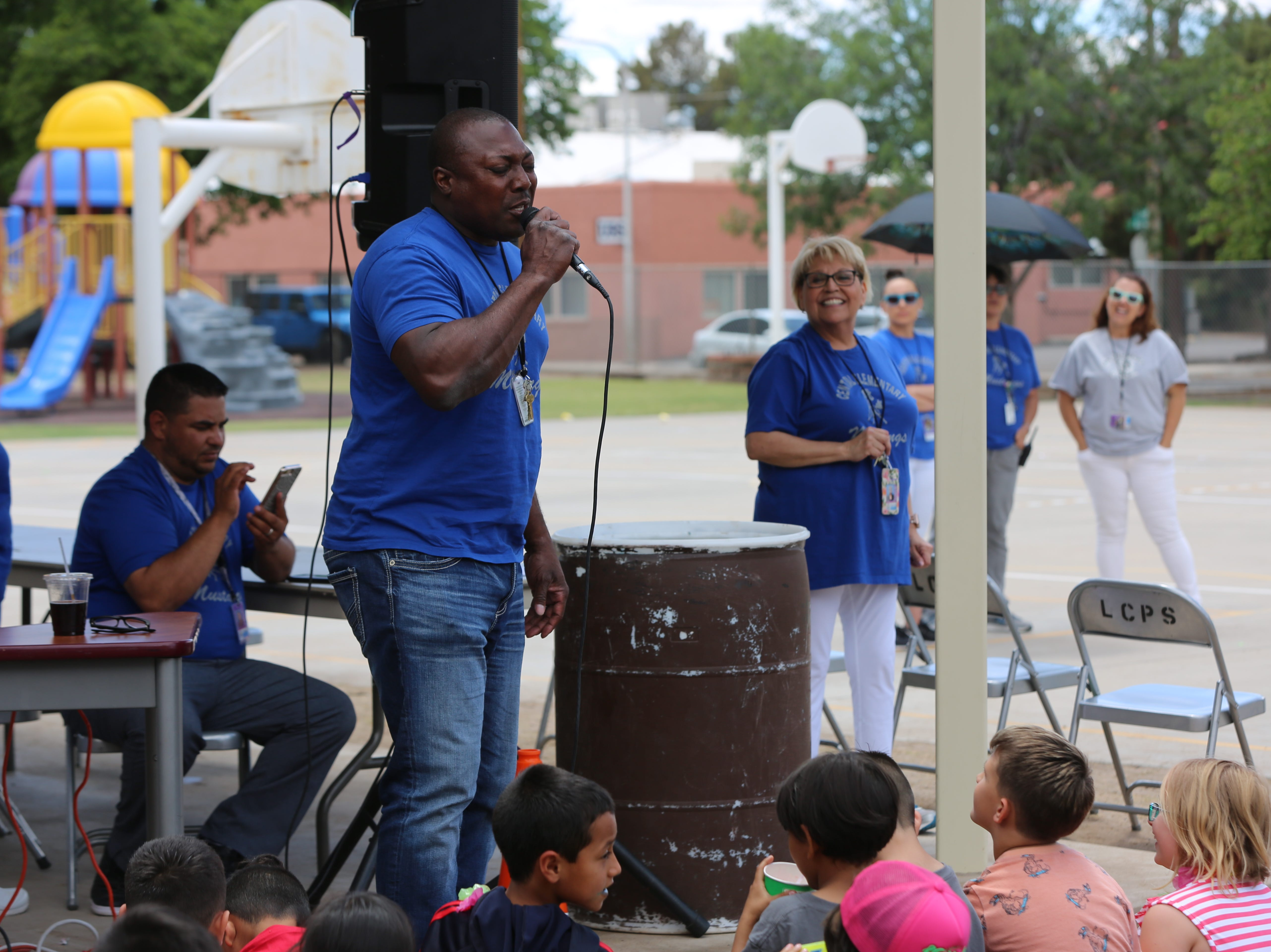 """Derek Harris, a music teacher at Central Elementary School, sings """"Happy Birthday"""" to the school in honor of its 70th anniversary Wednesday, April 24."""