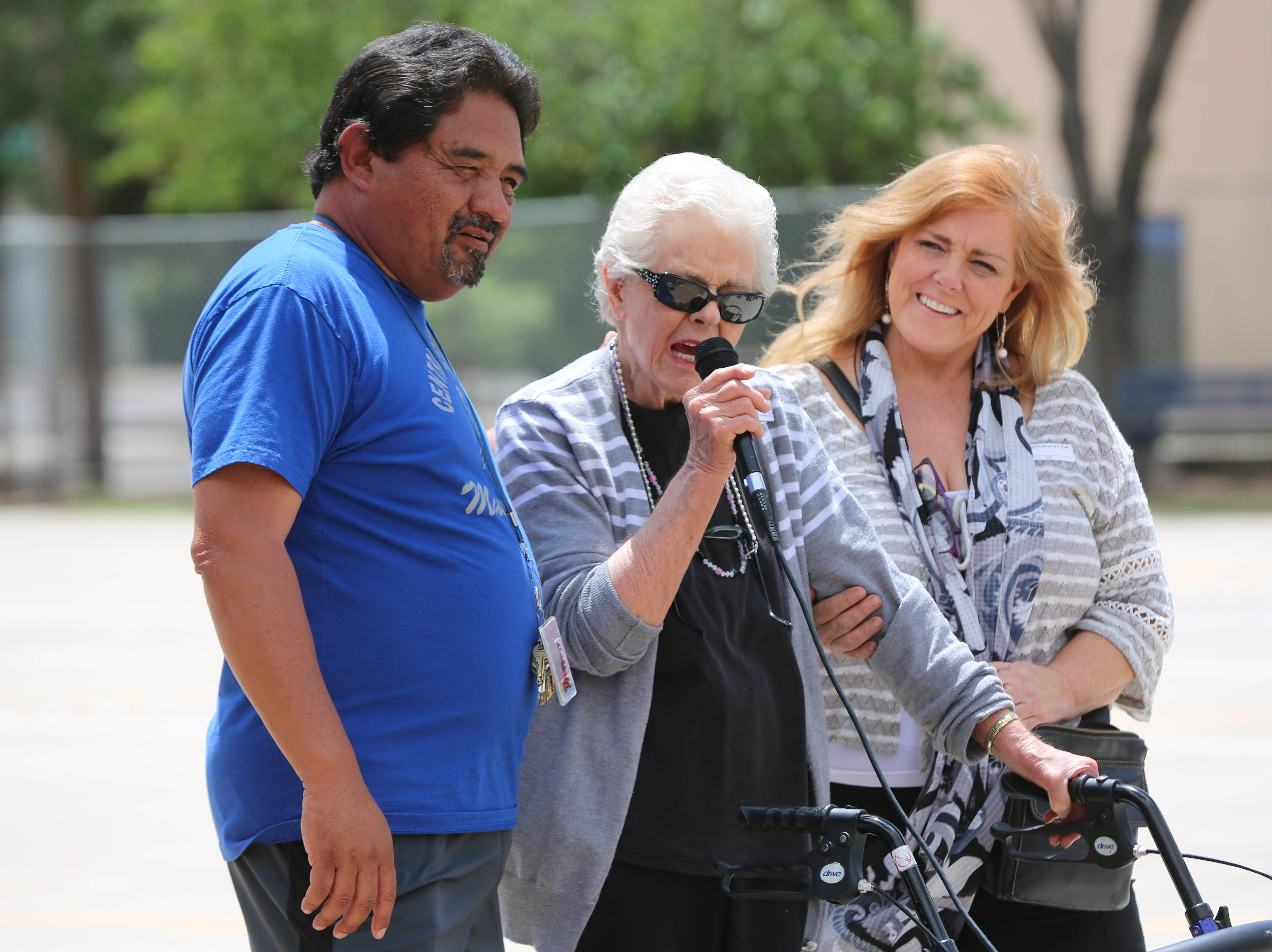 Sylvia Vaughn, center, was a fifth-grade teacher at Central Elementary School from 1968 to 1978. She visited the school during its 70th anniversary Wednesday, April 24. She stood with the help of Central Elementary School staff including P.E. teacher Tommy Esparza.