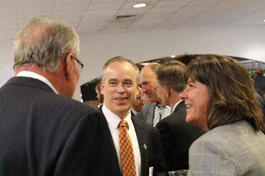 New Mexico Environment Department Cabinet Secretary James Kenney (center) speaks with the U.S. Department of Energy's Assistant Secretary of Environmental Management Anne White and others during a dinner to celebrate the Waste Isolation Pilot Plant, April 23, 2019 at the Pecos River Village Conference Center.