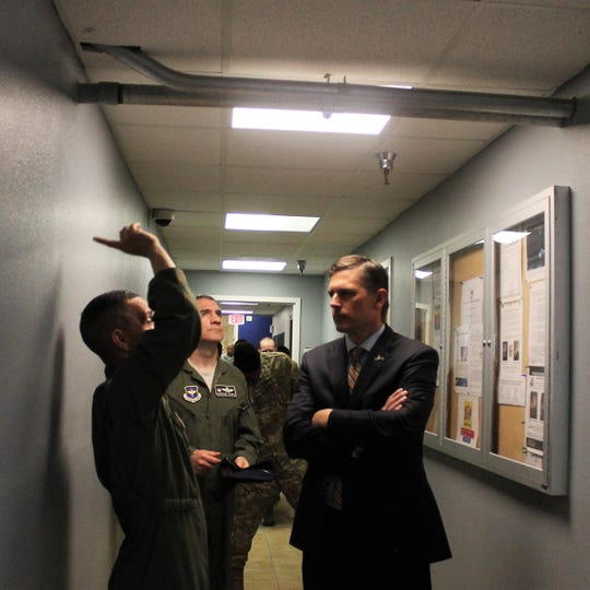 Lt. Col. Alfred Rosales, 6th Attack Squadron commander shows U.S. Senator Martin Heinrich and HAFB commander Col. Joseph Campo some issues with the 6th Attack Squadron MQ-9 Reaper Remotely Piloted Aircraft Formal Training Unit at Holloman Air Force Base Wednesday.