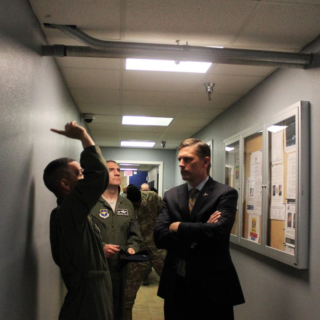 Lt. Col. Alfred Rosales shows U.S. Sen. Martin Heinrich and HAFB commander Capt. Joseph Campo some issues with the MQ-9 Reaper Remotely Piloted Aircraft Formal Training Unit at Holloman Air Force Base on April 24, 2019.