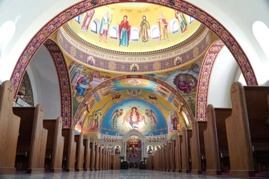 Near the entrance to the church's main worship area - showing its domed interior roof with its religioius murals.