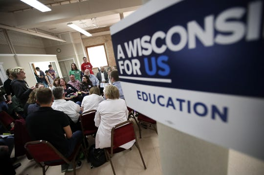 Lt. Gov. Mandela Barnes sits with a group as they discuss education during his stop with Gov. Tony Evers at the Oshkosh Senior Center for The People's Budget Listening Session Tour Tuesday, April 23, 2019, in Oshkosh, Wis.  Danny Damiani/USA TODAY NETWORK-Wisconsin