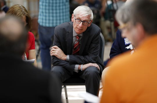 Gov. Tony Evers sits in on a group discussion about transportation during his stop at the Oshkosh Senior Center for The People's Budget Listening Session Tour Tuesday, April 23, 2019, in Oshkosh, Wis.  Danny Damiani/USA TODAY NETWORK-Wisconsin