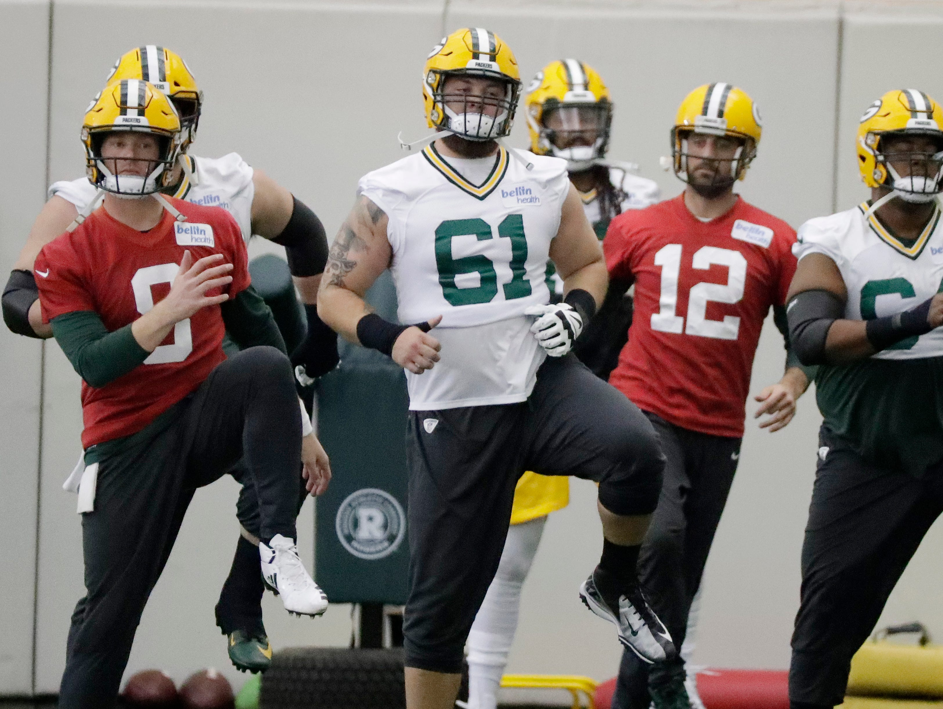 Green Bay Packers offensive guard Cole Madison (61) warms up during a team practice at the Don Hutson Center on Wednesday, April 24, 2019 in Ashwaubenon, Wis.