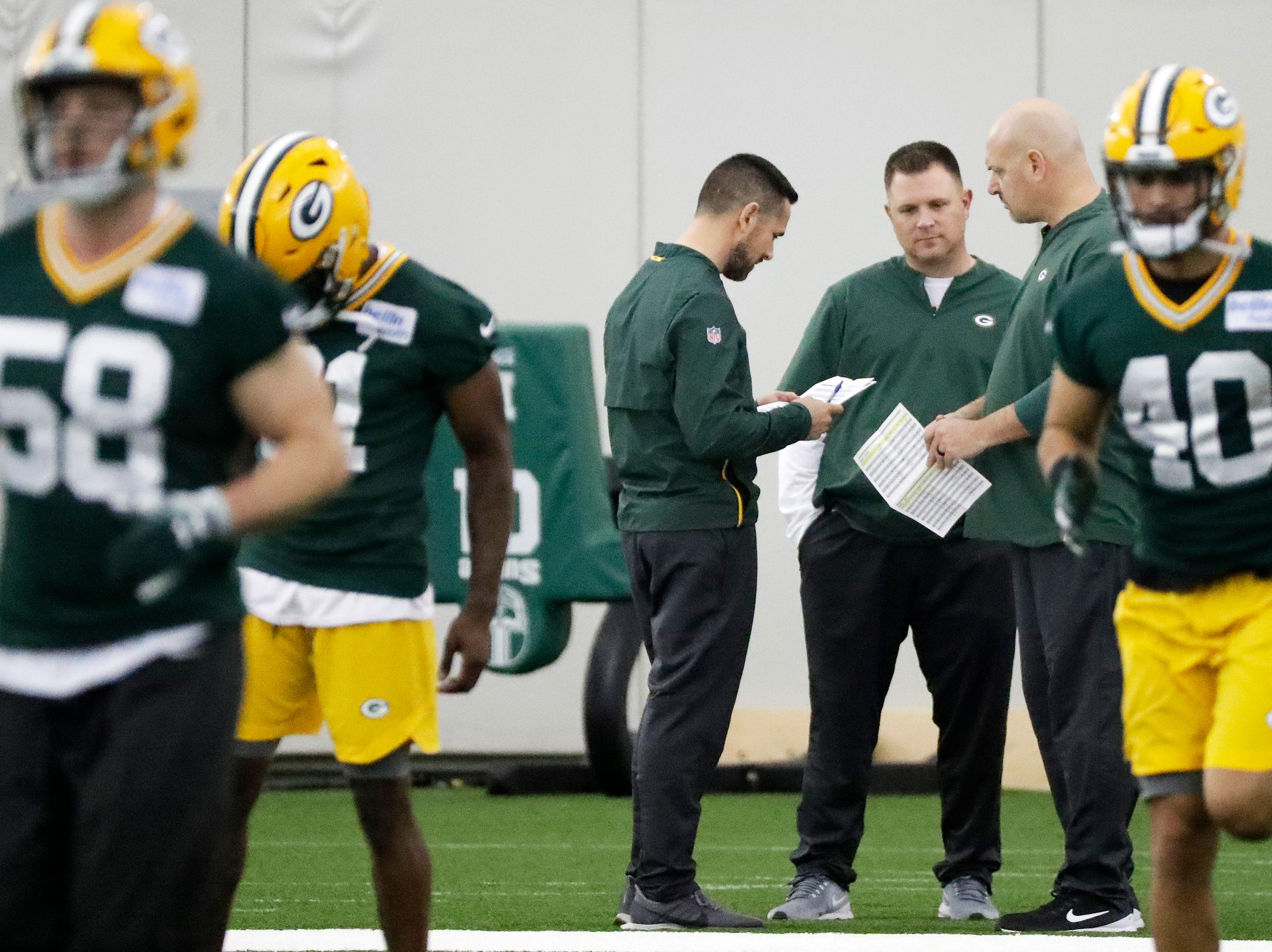 Green Bay Packers head coach Matt LaFleur, general manager Brian Gutekunst, and defensive coordinator Mike Pettine talk during a team practice at the Don Hutson Center on Wednesday, April 24, 2019 in Ashwaubenon, Wis.