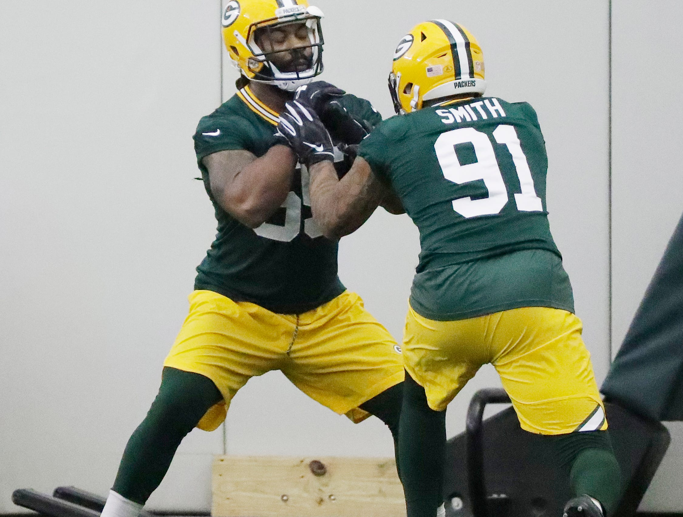 Green Bay Packers linebacker Za'Darius Smith (55) and linebacker Preston Smith (91) during a team practice at the Don Hutson Center on Wednesday, April 24, 2019 in Ashwaubenon, Wis.