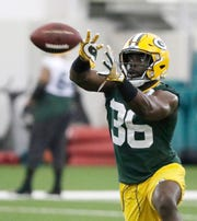 Green Bay Packers defensive back Raven Greene catches a pass during a team practice at the Don Hutson Center on April 24.