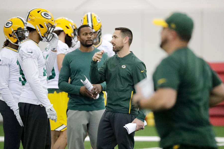 Green Bay Packers head coach Green Bay Packers head coach Matt LaFleur talks to wide receiver Equanimeous St. Brown (19) during a team practice at the Don Hutson Center on Wednesday, April 24, 2019 in Ashwaubenon, Wis.