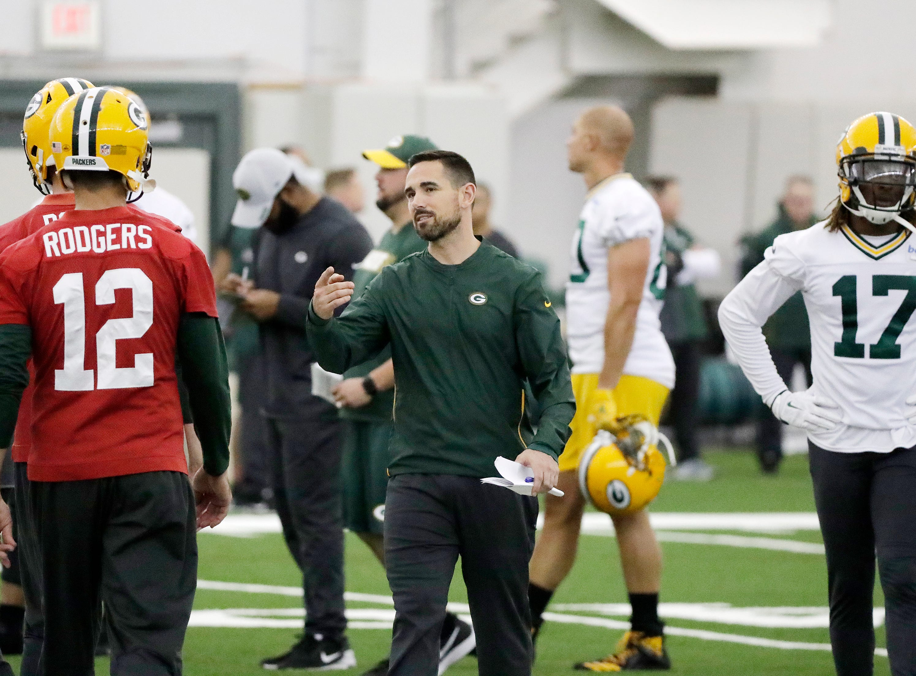 Green Bay Packers head coach Matt LaFleur talks to quarterback Aaron Rodgers (12) during a team practice at the Don Hutson Center on Wednesday, April 24, 2019 in Ashwaubenon, Wis.