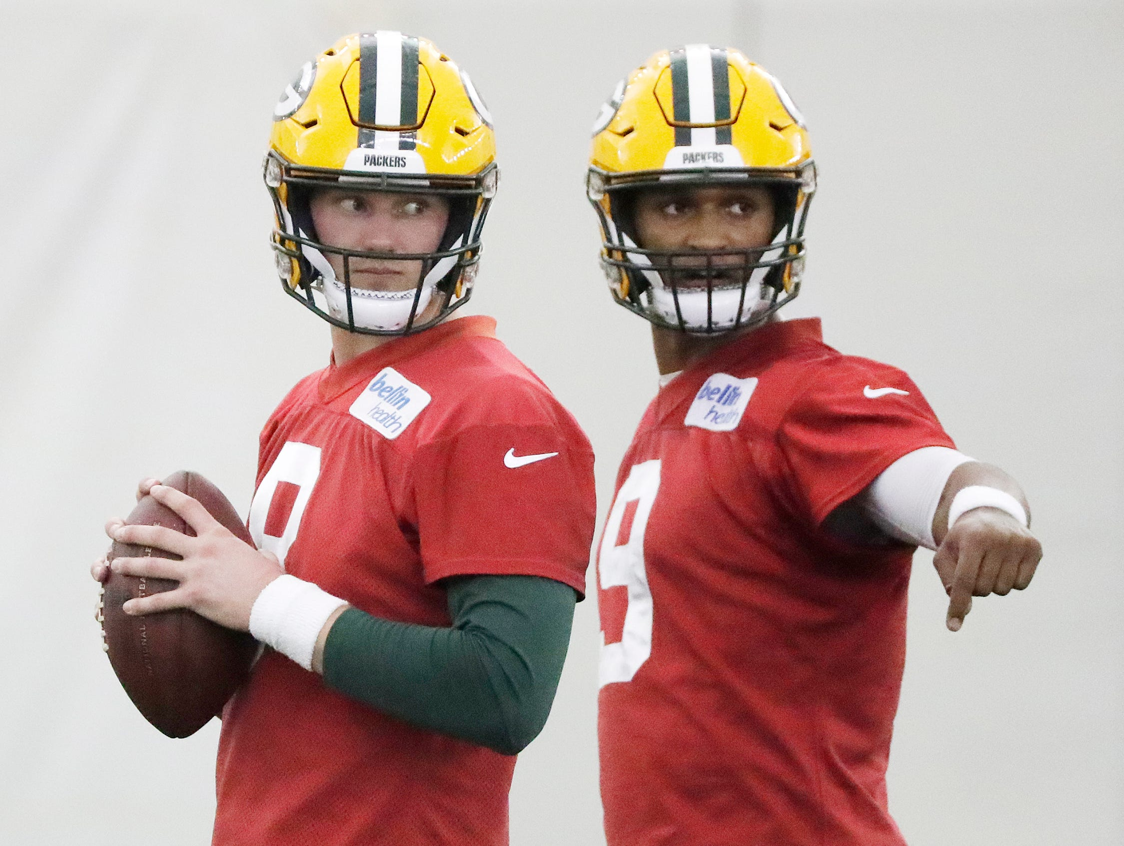Green Bay Packers quarterback Tim Boyle (8) and quarterback DeShone Kizer (9) talk during a team practice at the Don Hutson Center on Wednesday, April 24, 2019 in Ashwaubenon, Wis.