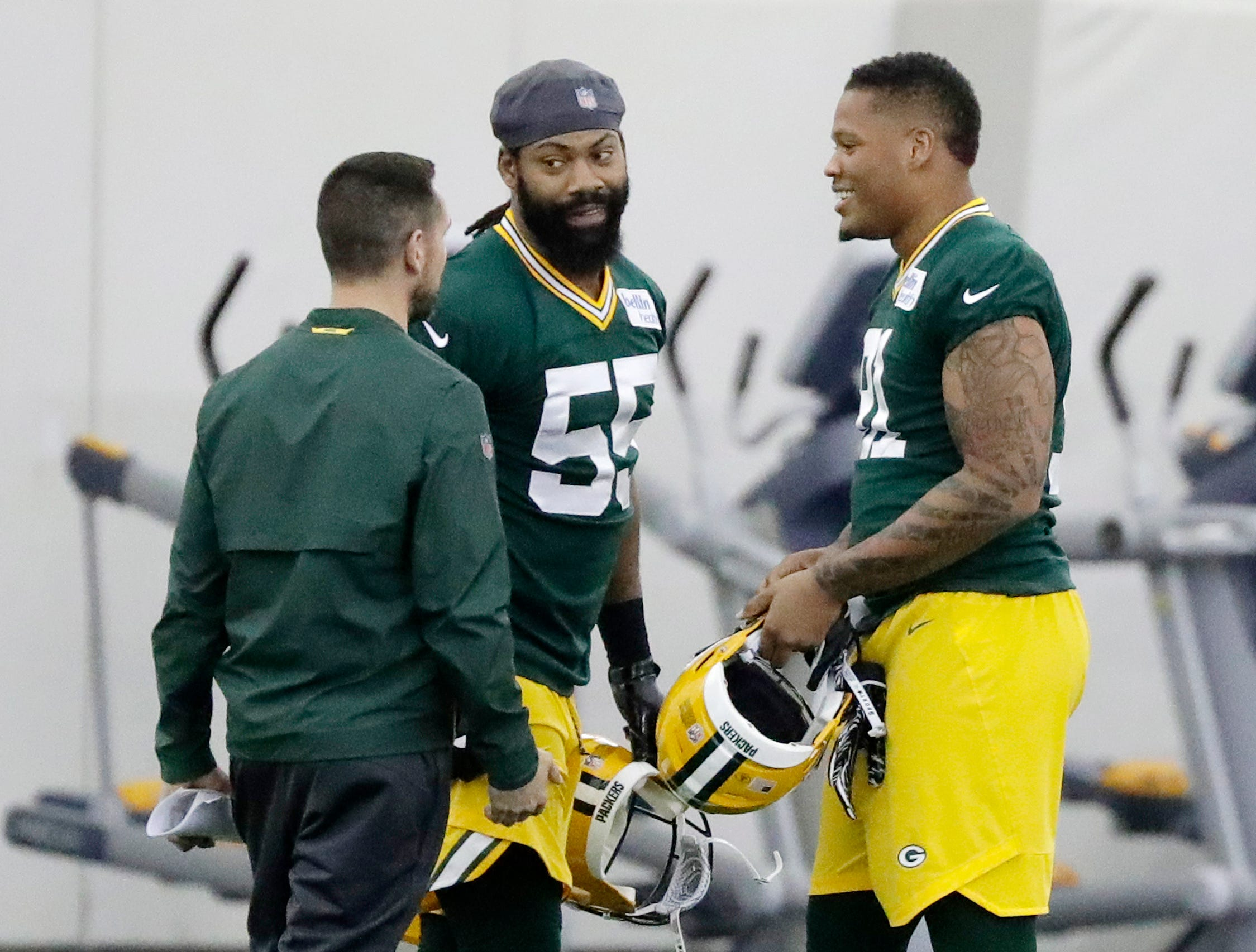 Green Bay Packers linebacker Za'Darius Smith (55) and linebacker Preston Smith (91) talk to head coach Matt LaFleur during a team practice at the Don Hutson Center on Wednesday, April 24, 2019 in Ashwaubenon, Wis.