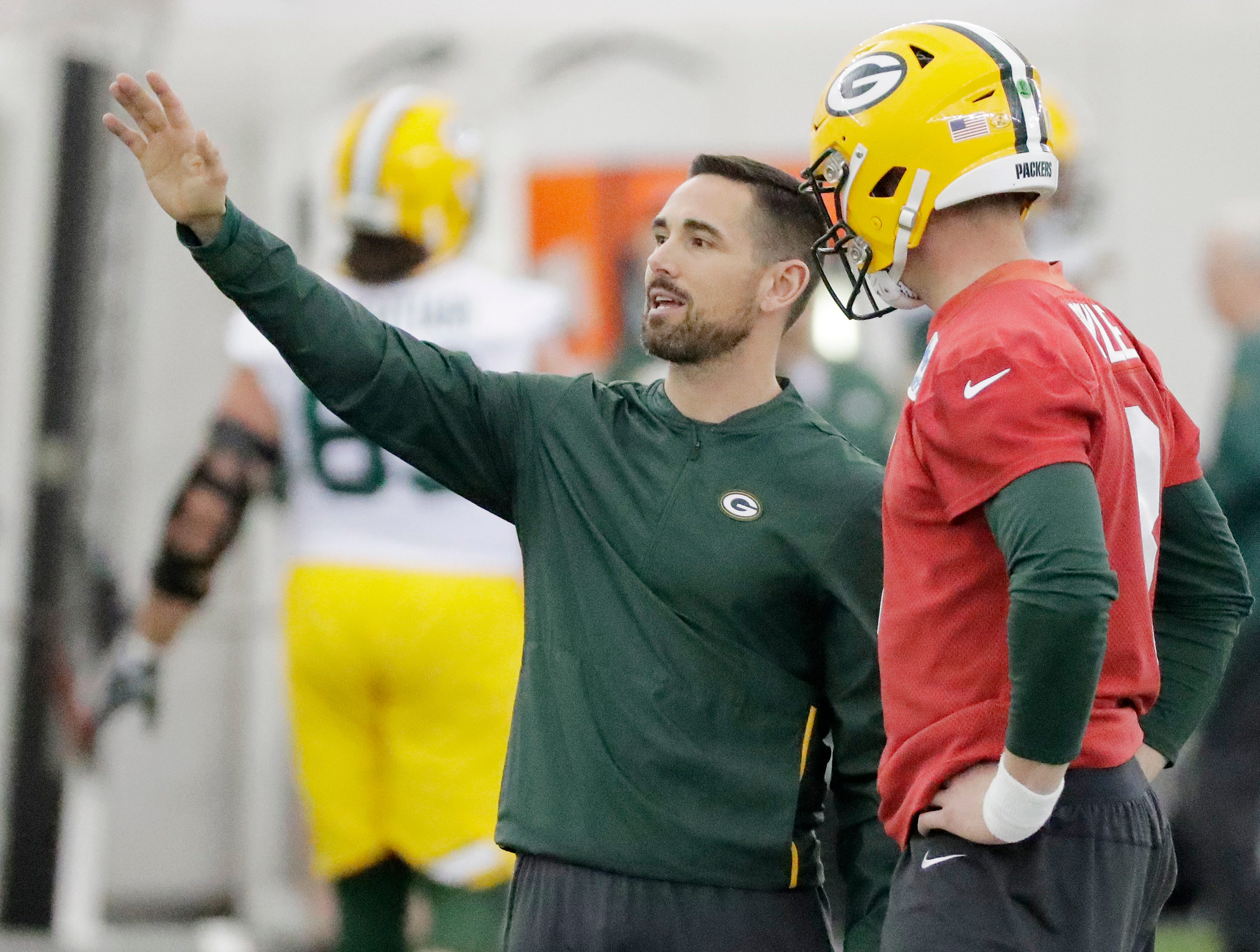Green Bay Packers head coach Matt LaFleur talks to quarterback Tim Boyle (8) during a team practice at the Don Hutson Center on Wednesday, April 24, 2019 in Ashwaubenon, Wis.