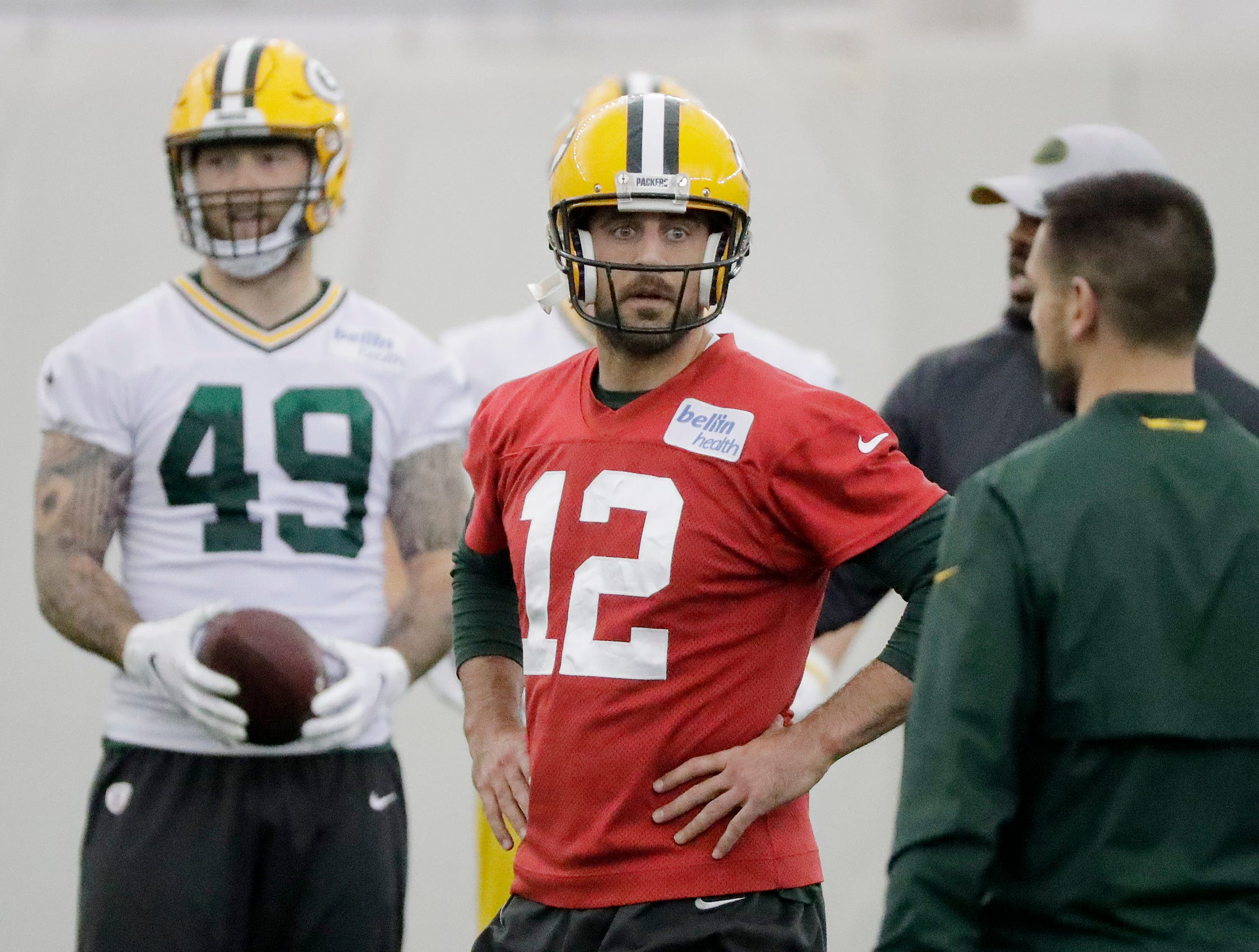 Green Bay Packers quarterback Aaron Rodgers (12) talks to head coach Matt LaFleur during a team practice at the Don Hutson Center on Wednesday, April 24, 2019 in Ashwaubenon, Wis.