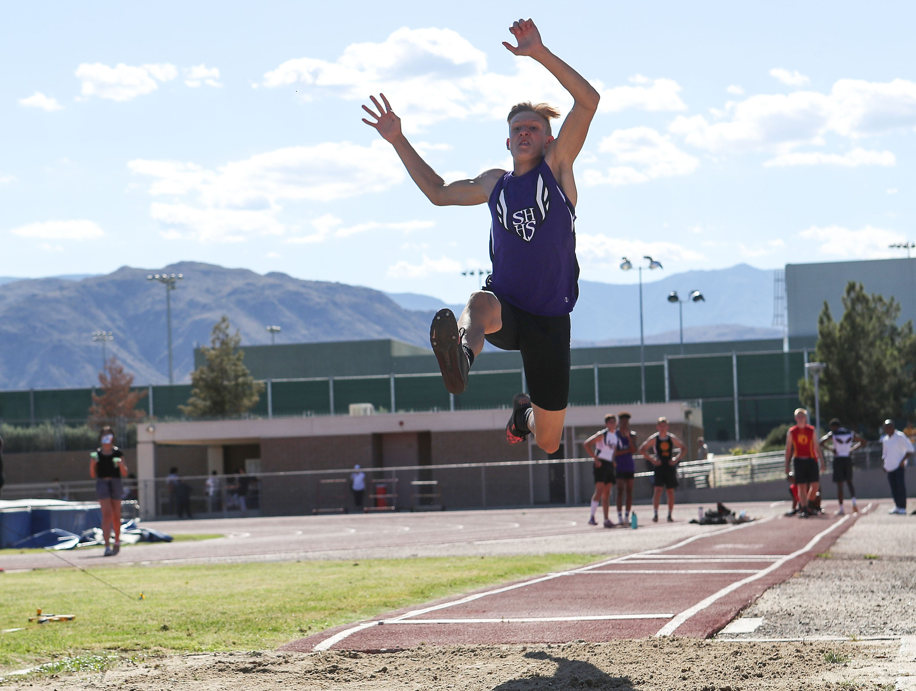 Cord Stansberry competes in the long jump during the Desert Empire League track championships at Palm Desert High School, April 23, 2019.