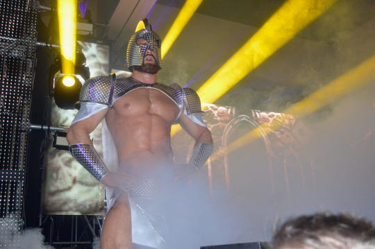 A dancer performs at the White Party in 2016.