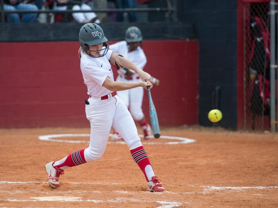 Kenzi Wiley (20) hits a single during the Tate vs West Florida softball game at West Florida High School in Pensacola on Tuesday, April 23, 2019.