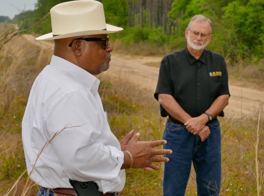 Russell Morgan, state conservationist with the Natural Resources Conservation Service, and Jimmy Bullock, senior vice president of Resource Management Service, talk Wednesday while touring Santa Rosa County forest land.