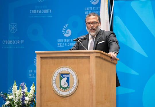 Harry Coker Jr., executive director of the National Security Agency, speaks Wednesday during the Centers of Academic Excellence Executive Leadership Forum hosted by the University of West Florida's Center for Cybersecurity.