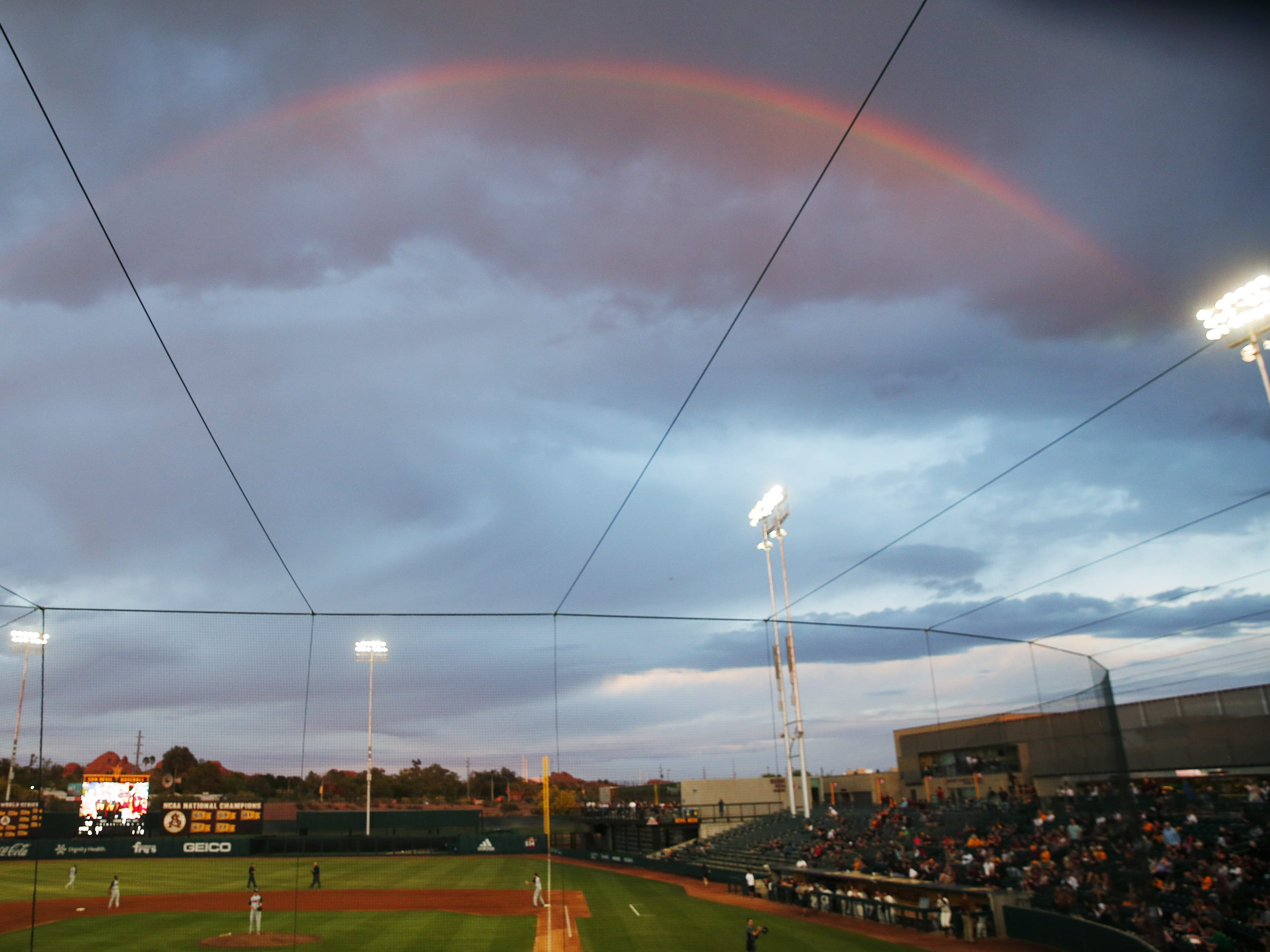 A rainbow forms over Phoenix Municipal Stadium during NCAA baseball game between ASU and UNLV in Phoenix April 23, 2019.