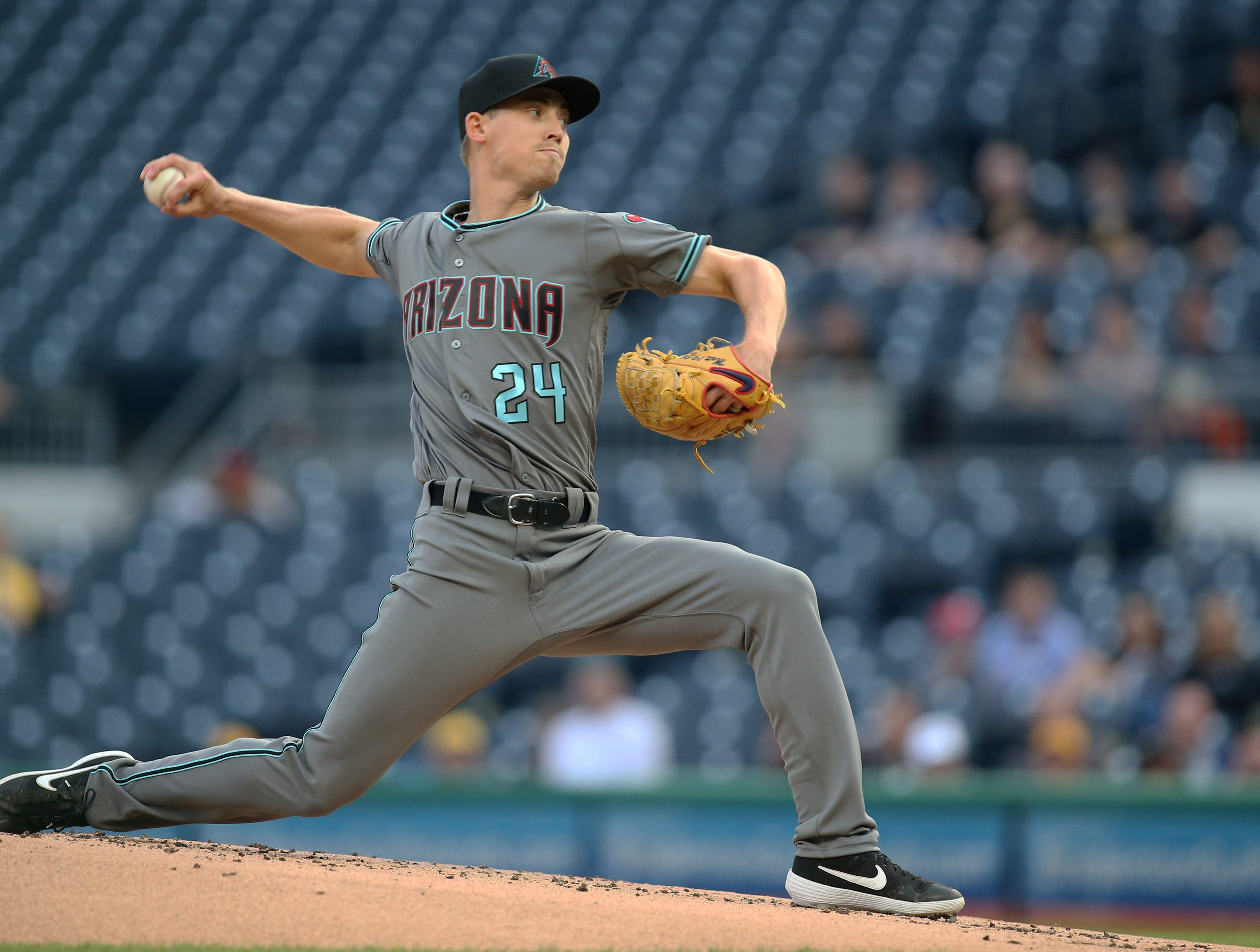 Apr 23, 2019; Pittsburgh, PA, USA;  Arizona Diamondbacks starting pitcher Luke Weaver (24) delivers a pitch against the Pittsburgh Pirates during the first inning at PNC Park. Mandatory Credit: Charles LeClaire-USA TODAY Sports