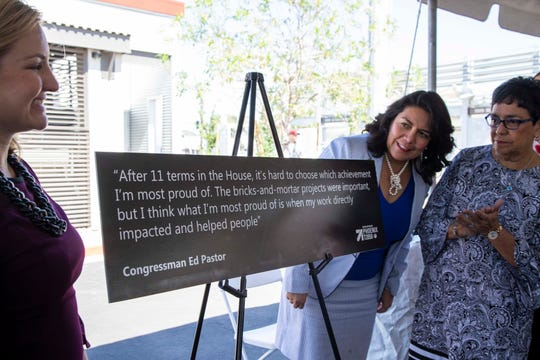Phoenix Mayor Kate Gallego (left) with Phoenix Councilwoman Laura Pastor (right) and her mother Verma Pastor (far right) helped unveil a plaque featuring a quote from former Congressman Ed Pastor.