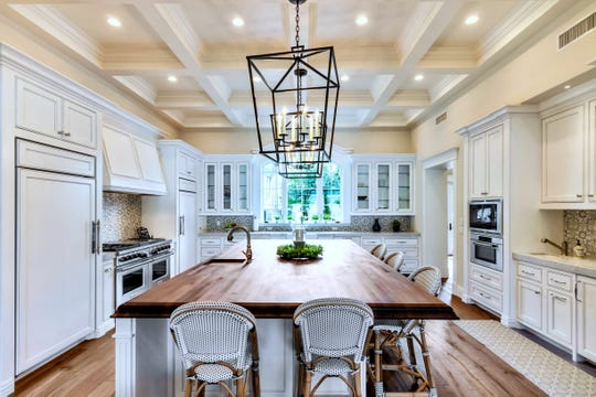 The 5,323-square-foot Phoenix home purchased by Jill M. Brown includes a gourmet kitchen with a coffered ceiling, accent lighting, and custom furniture grade cabinetry.