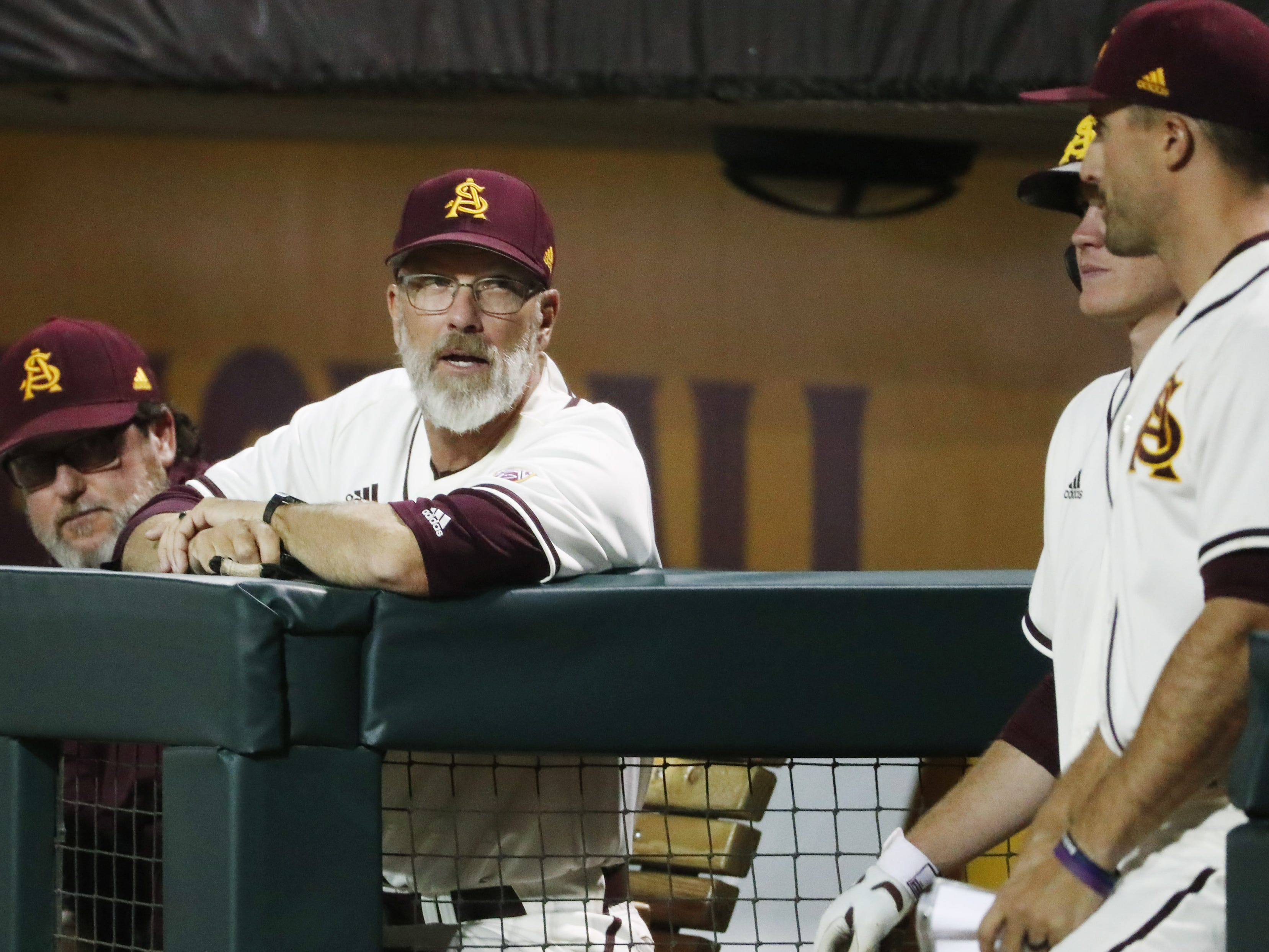 ASU baseball coach Tracy Smith talks to his players during the sixth inning against UNLV in Phoenix April 23, 2019.