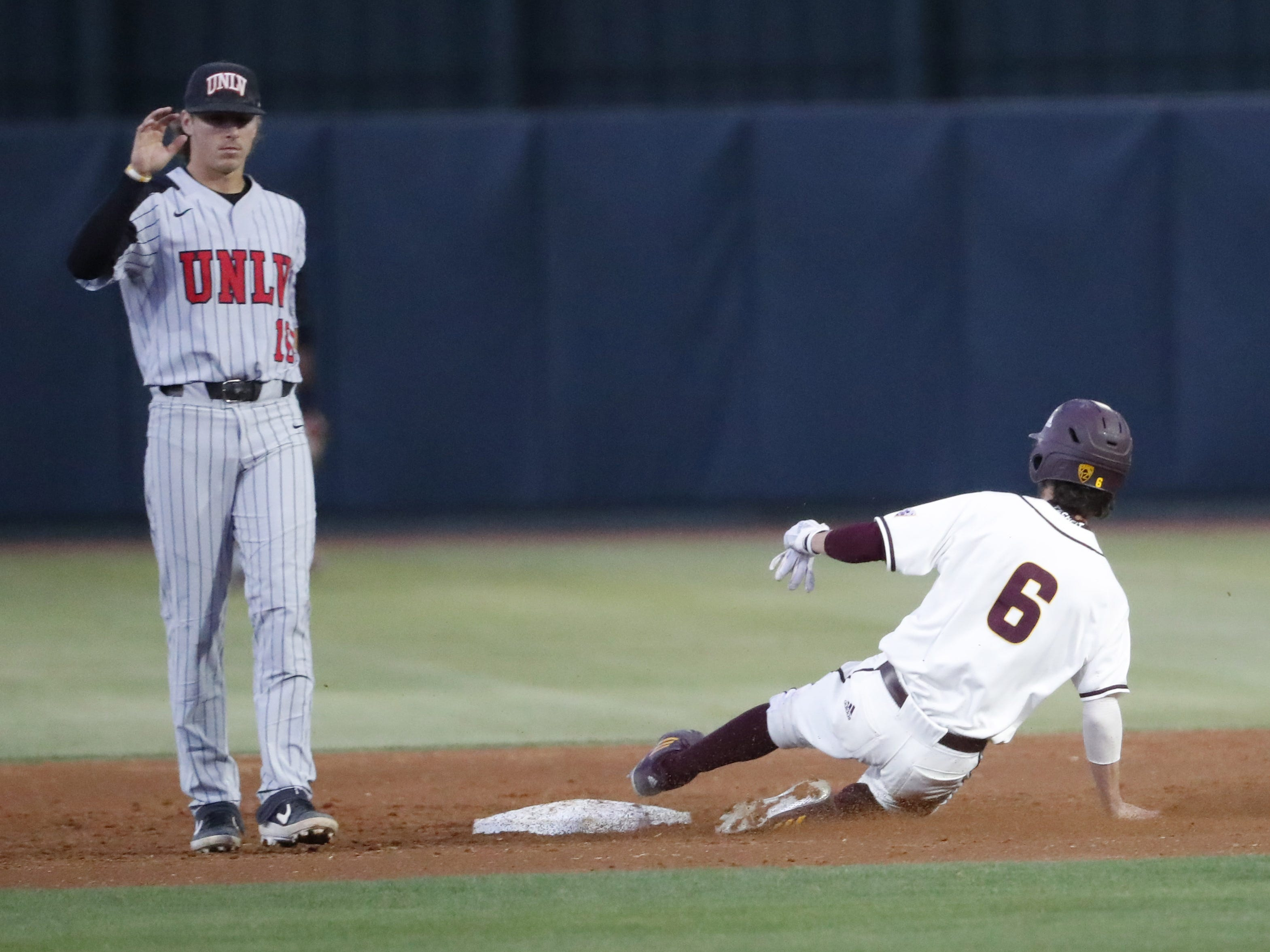 ASU's Drew Swift (6) steal second base against UNLV during the second inning in Phoenix April 23, 2019.