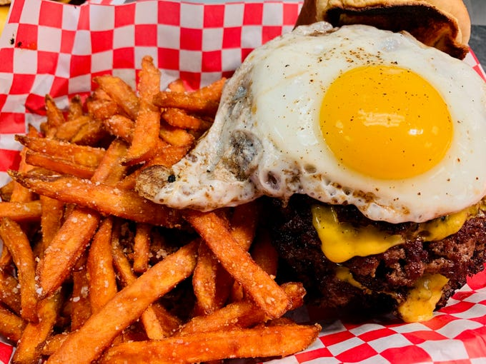 The Triple Crown steakburger at Matty G's Steakburgers & Spirits is topped with bacon and a fried egg.